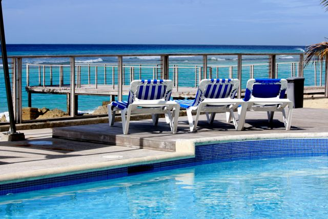 Hang out at our sparkling blue pool and listen to the rhythm of the waves of the Caribbean