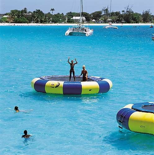 The trampolines at the Boatyard feature Barbados' flag colors.